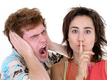 Man Screaming and Woman Making Silence Gesture. On white Stock Image
