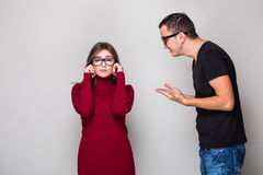 Man screaming on woman. Young men screaming on woman Royalty Free Stock Photography