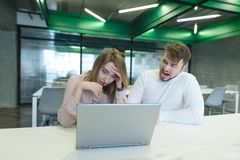 Man screams for a girl who is sitting at a computer, a failure at work. Boss weld worker. Aggression in the office. A men screams for a girl who is sitting at a stock images