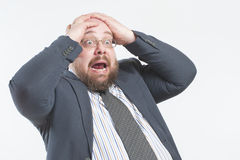 The man screams in horror holding his head. stock images