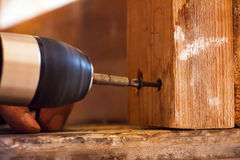 Man Screwing a screw into the wood. Element by means of the electrical screwdriver 4 Stock Photo