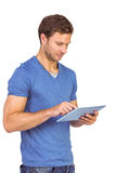 Man scrolling through tablet pc Royalty Free Stock Photography