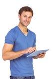 Man scrolling through tablet pc Royalty Free Stock Image