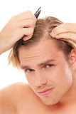 Man with scrubber Stock Image