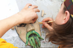 Man sculpting craft. With plasticine the form of face with moustache stock photos