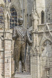 Man Sculpture in Front of Gothic Church Stock Images