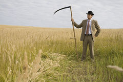 Man with scythe Royalty Free Stock Photography