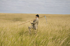 Man with scythe Royalty Free Stock Images