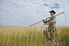 Man with scythe Stock Image