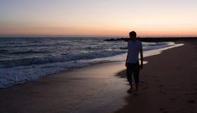Man at the sea. Man walking along the sea Royalty Free Stock Photography