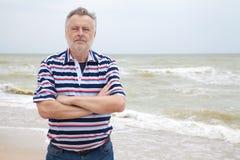 Man on the sea beach Stock Photos