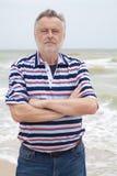 Man on the sea beach Stock Image