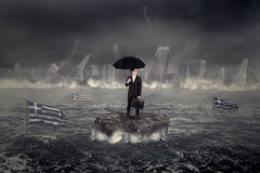 Man on the sea with the city and Greek flag sinking Stock Photography