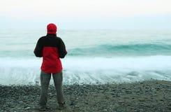 Man on sea coast Stock Images