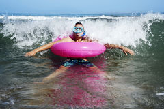 Man on the sea with diving mask and swim ring Stock Image
