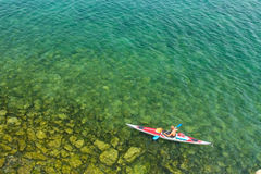 The man in a sea kayak on the lake Baikal Stock Photography