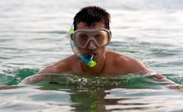 The man in the sea in a mask Royalty Free Stock Photo