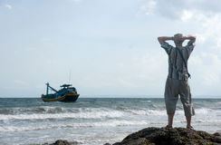 Man on the sea shore Royalty Free Stock Image