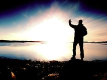 Man at sea. The sky and the man are reflected in a smooth water. In front of the sea Royalty Free Stock Images