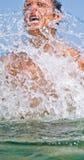 Man sea sprinkling water Royalty Free Stock Photo