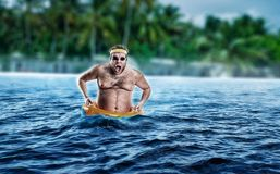Man in the sea while storming stock photo