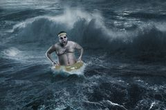 Man in the sea while storming royalty free stock photography