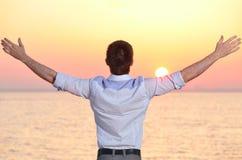 Man at sea sunrise. Businessman is looking at sea sunrise Royalty Free Stock Photos