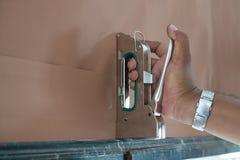 Man sealing paper on board. Using stapler Royalty Free Stock Photo