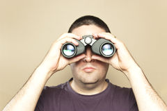 Man searches with binoculars. A man searches with binoculars Royalty Free Stock Images