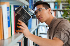 Man searching book in library Stock Photography