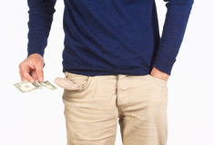 Man Searching for Cash in his Pockets Royalty Free Stock Images
