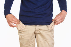 Man Searching for Cash in his Pockets Stock Images