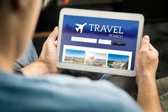 Man searching cheap flights, hotel or holiday package online. Man searching cheap flights, hotel or holiday package on internet by using online travel search stock image