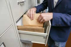 Man searching for documents. In archive Royalty Free Stock Photo
