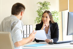 Man searching employment in a bad job interview. With the interviewer looking mistrustful Royalty Free Stock Image