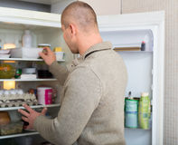 Man searching food in freezer. Man searching for food in the fridge Royalty Free Stock Images