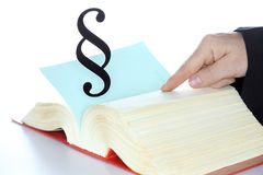 Man is searching in a law book. With paragraph symbol Royalty Free Stock Photo