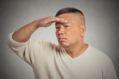 Man searching looking far away into future monitoring Royalty Free Stock Photography