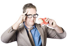 Man searching for opportunity of innovation. Nerd business man searching for opportunity of innovation with recycled binoculars in a think and invent concept Royalty Free Stock Image
