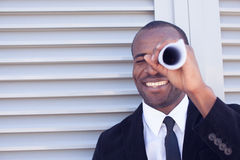 Man searching through paper spyglass Royalty Free Stock Photography