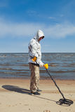 Man searching for a precious metal. Using a metal detector Stock Photo