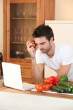 Man searching for a recipe Royalty Free Stock Image