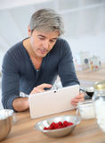 Man searching for recipe at home Royalty Free Stock Photography
