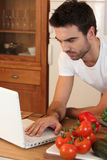 Man searching recipe on the Internet Royalty Free Stock Image