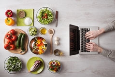 Man searching for recipes online Stock Images