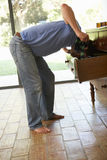 Man Searching For Something In Drawers Stock Image