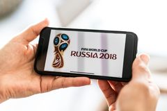 Man searching for tickets to FIFA World Cup Russia 2018 on the smartphone.  Royalty Free Stock Photos