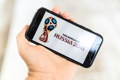 Man searching for tickets to FIFA World Cup Russia 2018 on the smartphone.  Stock Photo