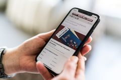 Man searching for tickets to FIFA World Cup Russia 2018 on the smartphone.  Stock Images
