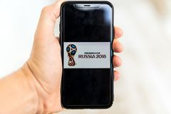 Man searching for tickets to FIFA World Cup Russia 2018 on the smartphone.  Royalty Free Stock Images